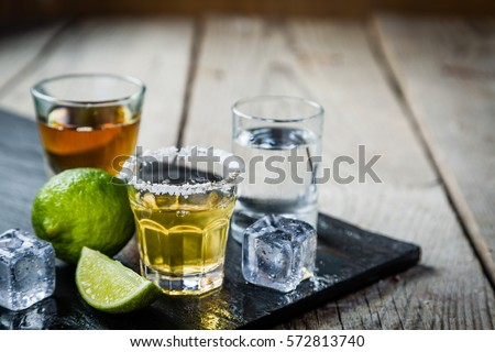 Selection of alcoholic drinks on rustic wood background #572813740