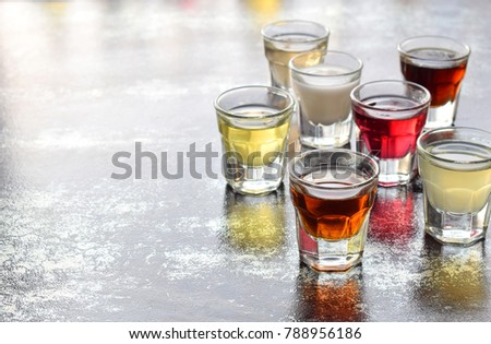 Selection of alcoholic drinks. Set of wine, brandy, liqueur, tincture, cognac, whiskey in glasses. Large variety of alcohol and spirits for making cocktails and drink. Copy space for text