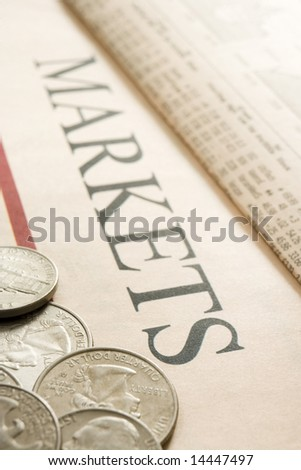 selection of american coins on paper marked Markets
