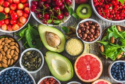 Selection of antioxidant food. Healthy superfood, detoxification with fruits and various berries. Fresh nourishment on table.