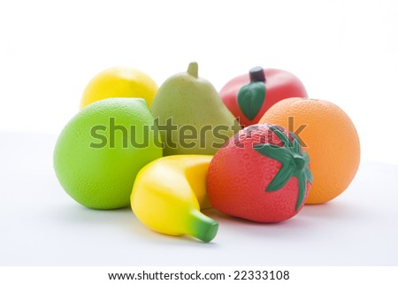 Selection Of Artificial Fruit On White Background