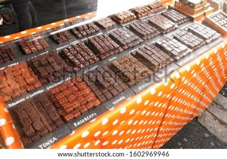 Selection of artisan chocolates variety displayed at stall in Borough Market, London