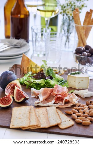 Selection of cheese and charcuterie with wine served as party snacks starters canapes