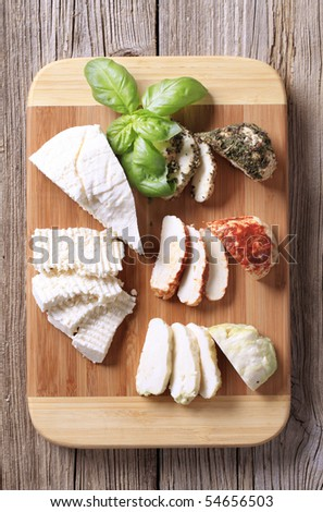 Selection of cheeses on a cutting board