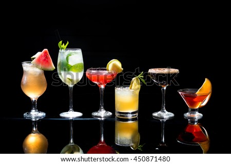 Selection of colorful festive Christmas drinks, alcoholic beverages and cocktails in elegant glasses on a dark background with copy space  #450871480