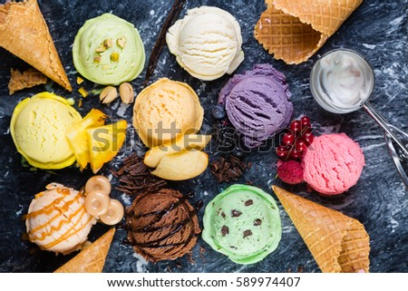 Selection of colorful ice cream scoops on marble background, top view #589974407