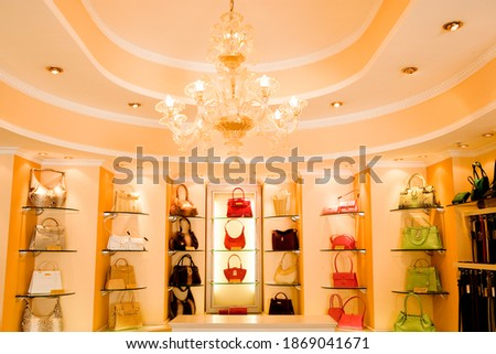 Selection of designer handbags on-shelf display in glamorous boutique. ストックフォト ©