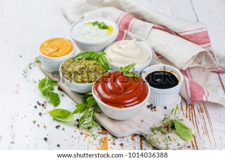 Selection of different sauces in bowls #1014036388
