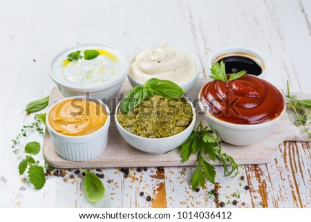 Selection of different sauces in bowls #1014036412