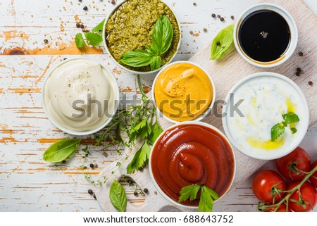 Selection of different sauces in bowls #688643752