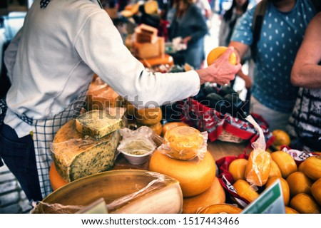 Selection of Dutch cheese at farmers traditional market. Food background