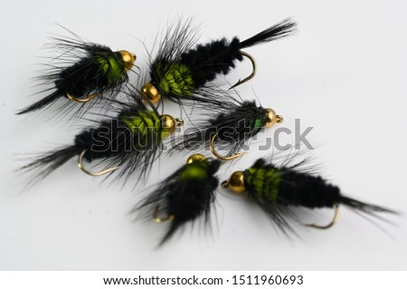 Selection of Fly fishing flies with gold head beads