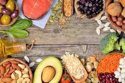 Selection of food that is good for the heart on old wooden background. Copyspace background. Top view.