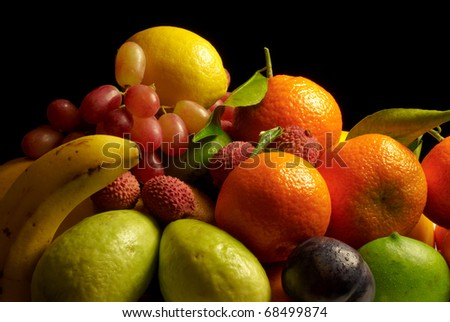 Selection of fresh fruit against a black background