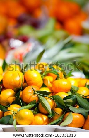 Selection of fresh oranges at market