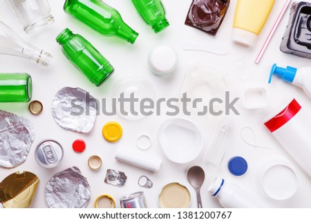 Selection of garbage for recycling - metal, plastic, and glass. Concept of recycling