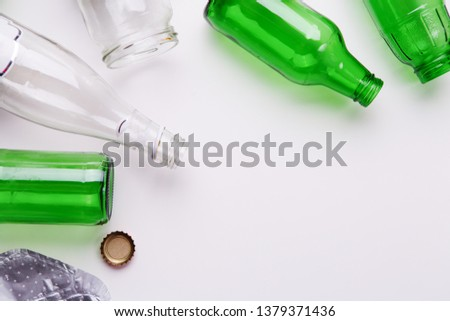 Selection of glass garbage for recycling on white background. Concept of recycling