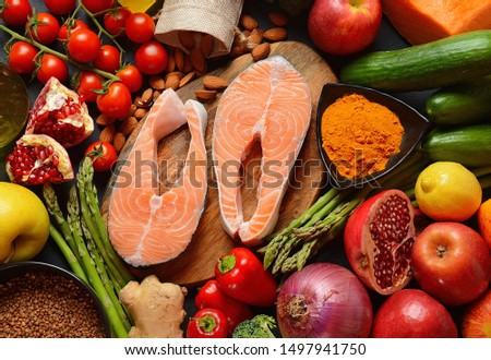 Selection of healthy products- salmon, almonds, pumpkin, buckwheat, pomegranate, curcuma powder, olive oil, broccoli, ginger, asparagus,apples. Balanced diet concept Omega 3 #1497941750