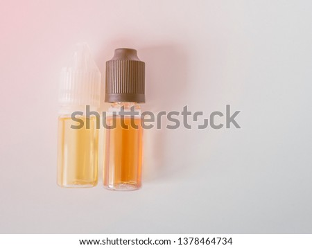 Selection of liquid for vape device. Change habit of smoking. Concept for more healthy life. Different tastes of liquids for e-cigarette, flat lay for advertising #1378464734