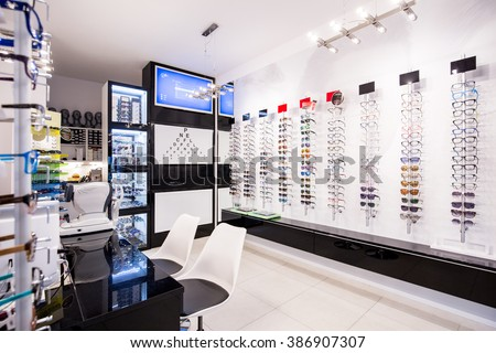 Selection of modern eyeglasses rims at optician\'s store