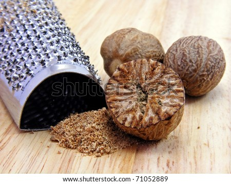 Selection of nutmeg with stainless steel hand grater