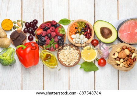 Selection of nutritive food - heart, cholesterol, diabetes, copy space.