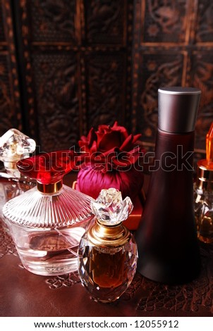 Selection of perfume bottles in romantic setting. Copy space on top.
