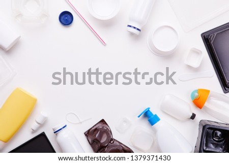 Selection of plastic garbage for recycling on white background. Concept of recycling