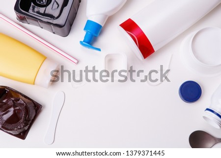 Selection of plastic garbage for recycling on white background.. Concept of recycling