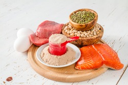 Selection of protein sources, white wood background