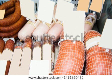 Selection of sausages at a butchers counter or delicatessen window