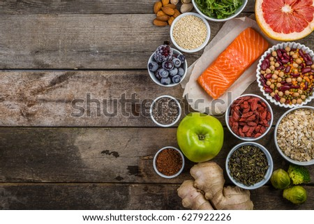 Selection of superfoods on rustic background #627922226