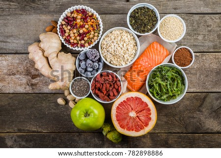 Selection of superfoods on rustic background, copy space - Shutterstock ID 782898886