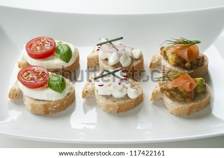 Selection of vegetarian appetizers arranged on white plate