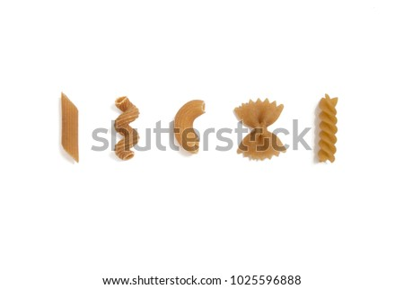 selection of whole grain pasta uncooked, isolated on white background