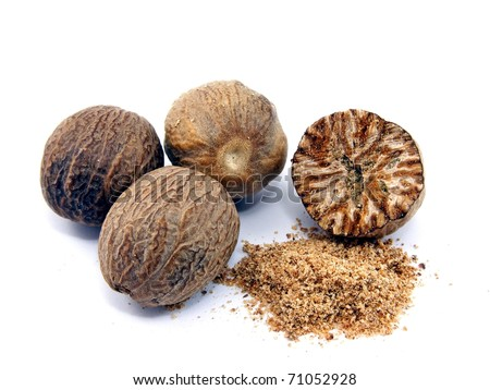 Selection of whole & grated nutmeg on white background