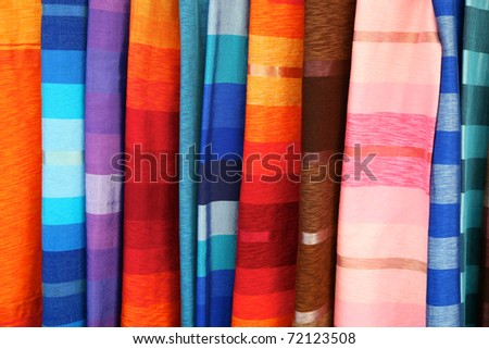 Selection of wonderfully bright colorful cloth at a market stall in Fez, Morocco