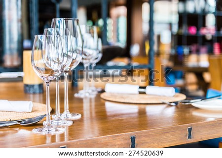 Selectiv soft focus on Wine glass on dining table in restaurant