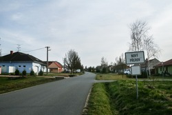 Selective blur on a Roadsign indicating the entrance to Novy Prerov, in Czech republic, with a deserted empty street. Novy Prerov is a typical Czech Moravian village of the South Moravia region.