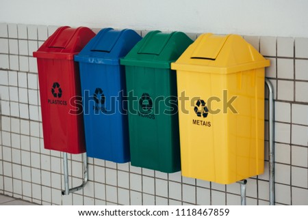 Selective collection of garbage with inscriptions in Portuguese #1118467859