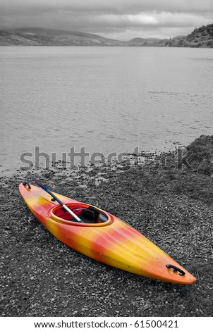 selective color, kayak beached on lake shore