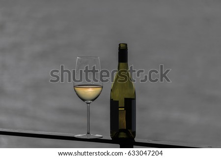 Selective color white wine on deck rail with bottle