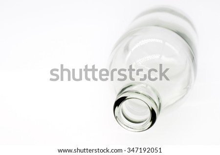 Selective focus at detail of glass bottles on white background. Concept image #347192051