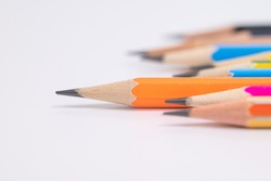Selective focus  different muticolored pencils on white background.Difference concept.