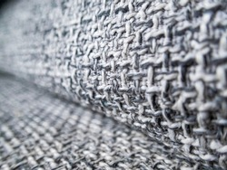 selective focus fabric texture on macro fabric sofa background image texture gray pattern interspersed with black