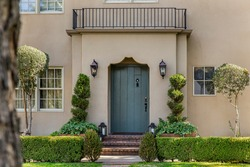 Selective focus featuring entry door of classic style home.