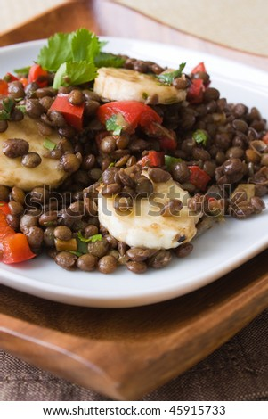 Selective focus image of an African bananas lentils salad.
