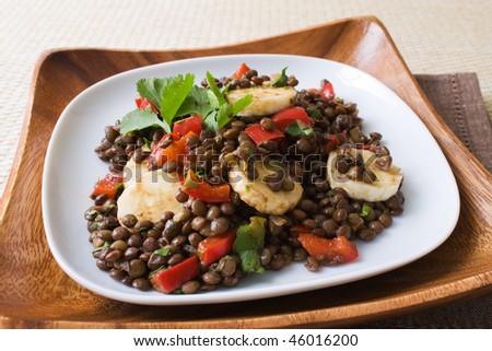 Selective focus image of an African bananas lentils salad.
