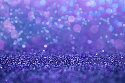 Selective focus in the middle for your product. Purple glitter abstract background with defocus lights. Violet sparkle glitter abstract background. Circle, abstraction.