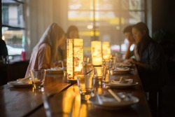 selective focus lighting with customer inside cozy restuarant